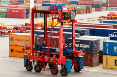 Straddle carrier is waiting to pick up containers at the Buchardkai Container Terminal in Hamburg Royalty Free Stock Photo