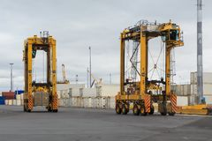 Straddle carriers in a busy port stock photo