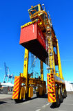 Straddle carriers and containers on Fergusson Wharf Stock Photo