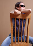 Straddling a chair Royalty Free Stock Photos