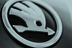 Straelen Germany June 27th 2018: Close up of wet Skoda logo emblem. Close up of wet Skoda logo emblem royalty free stock photography