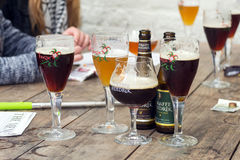 Straffe Hendrik and Brugse Zot belgian beers on wooden table Royalty Free Stock Image