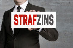 Strafzinz in german negative interest sign is held by business Royalty Free Stock Photography