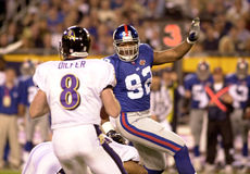 Strahan goes after Trent Dilfer Royalty Free Stock Photography