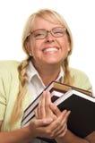 Strahlende Frau trägt Stapel Bücher Stockfotos