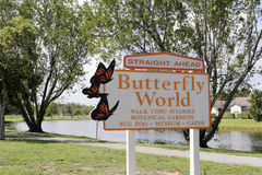 Straight Ahead Butterfly World Sign. Coconut Creek, FL, USA - July 21, 2015: Butterfly World sign that says, Straight Ahead and lists its features. Butterfly Royalty Free Stock Photo