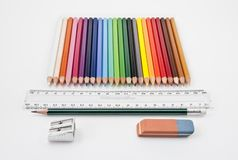 Straight alignment of basic school supplies. On a white background royalty free stock photography