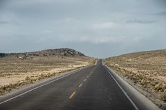 Straight altitude highway. High altitude landscape with straight highway in Peru stock images