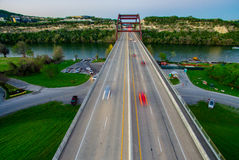 Straight On Angle Aerial Pennybacker Bridge at sunset with cars showing motion from Long Exposure taken by Drone Stock Photos