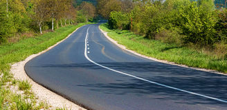 Straight asphalt road Stock Images