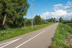 Straight asphalt road through a rural area Royalty Free Stock Photo