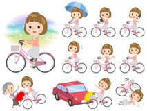 Straight bangs hair pink blouse women ride on city bicycle Stock Photography