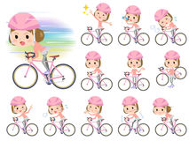 Straight bangs hair pink wear women ride on rode bicycle Stock Images