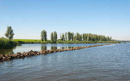 Straight barrier in a Dutch river Stock Photo