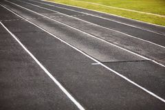 Straight black Running Track  on the athletics stadium. royalty free stock image