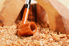 Straight briar smoking pipe on wood Royalty Free Stock Photo