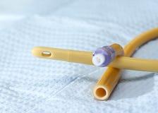 Straight Catheter. Closeup of straight catheter on sterile field Stock Photography