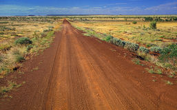 Straight country road. Straight country sandy road in the outback Royalty Free Stock Images