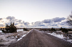 Straight dirt road. Crossing the Great Alvar Plain at the island Oland in Sweden. Photo taken a frosty early morning at springtime Stock Photo