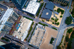 Straight down View above Austin , Texas modern buildings and skyscrapers. Aerial drone view above intersecting streets and modern city hall , solar panels , and royalty free stock photo