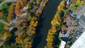 Straight down view along the Boise River tree lines in fall color. Aerial view of the Boise River in Idaho in fall stock video