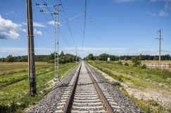 Straight electric railroad. Electric railroad in Niitvälja, Estonia stock images