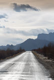 The straight and empty road of Friendship in Tibet crossing the Royalty Free Stock Image