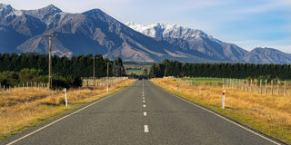 Straight empty road heading towards Mount Cook, New Zealand. Royalty Free Stock Photography