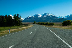 Straight empty road to Mount. New Zealand Stock Photo