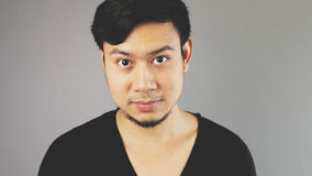 Straight face. An asian guy with black t-shirt royalty free stock photography