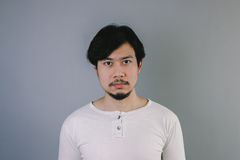 Straight face of Asian man. royalty free stock photo