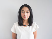 Straight face of Asian woman. stock photography