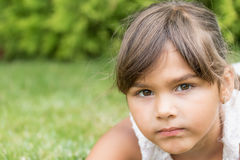 Straight face of little girl closeup Royalty Free Stock Photo