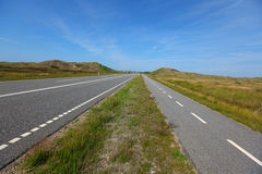 Straight, flat road landscape with a bicycle lane. In Scandinavia stock image