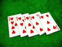 Straight Flush. Playing cards displaying a straight flush in a game of poker Stock Image