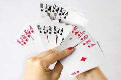 Playing cards. Straight flush. White background. Straight flush from all pair of playing cards. White background Stock Photo