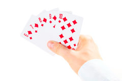 Straight flush combination taking by man's hand Royalty Free Stock Photos