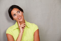 Straight hair lady with hand on chin Royalty Free Stock Images