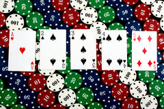 Straight Hand. A winning hand called 'Straight' in a poker game, on a background of colorful gambling chips Royalty Free Stock Photo