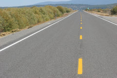 Straight Highway. Through the desert; clean, crisp, sharp image; not cropped from original Stock Photography