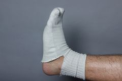 Straight leg with a big hole in the sock Stock Image