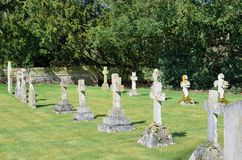 Straight line of gravestones in graveyard Stock Photos