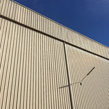 Straight lines of metal sheet siding, Texture background. Stock Photos