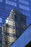 Reflection of a tall building in a glass and metal skyscraper Stock Photography