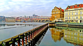 Straight lines. A view of the famous historic Charles bridge bridge over the Moldava, located in the city of Prague, and connects the Old Town to the Malá stock image