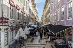 Straight and long street of Lisbon from Figueira square to Comercio square royalty free stock images