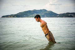 Straight man diving to ocean Royalty Free Stock Photo