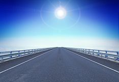 Straight motorway with a guiding star over horizon. Concept of moving forward stock photo