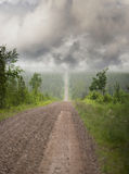 Straight narrow dirt road Royalty Free Stock Image