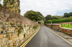 Straight Narrow Road Lined with Stone Walls Stock Images